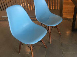 4 baby blue chairs