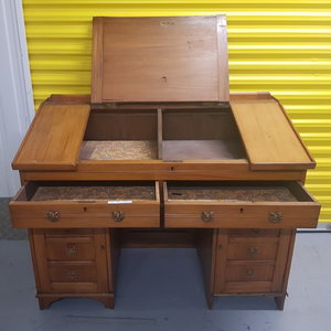 Solid wood antique writing desk.