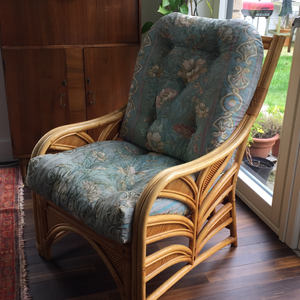 Two identical cane armchairs