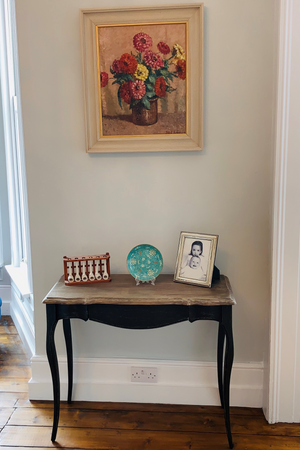 Two Designer console tables
